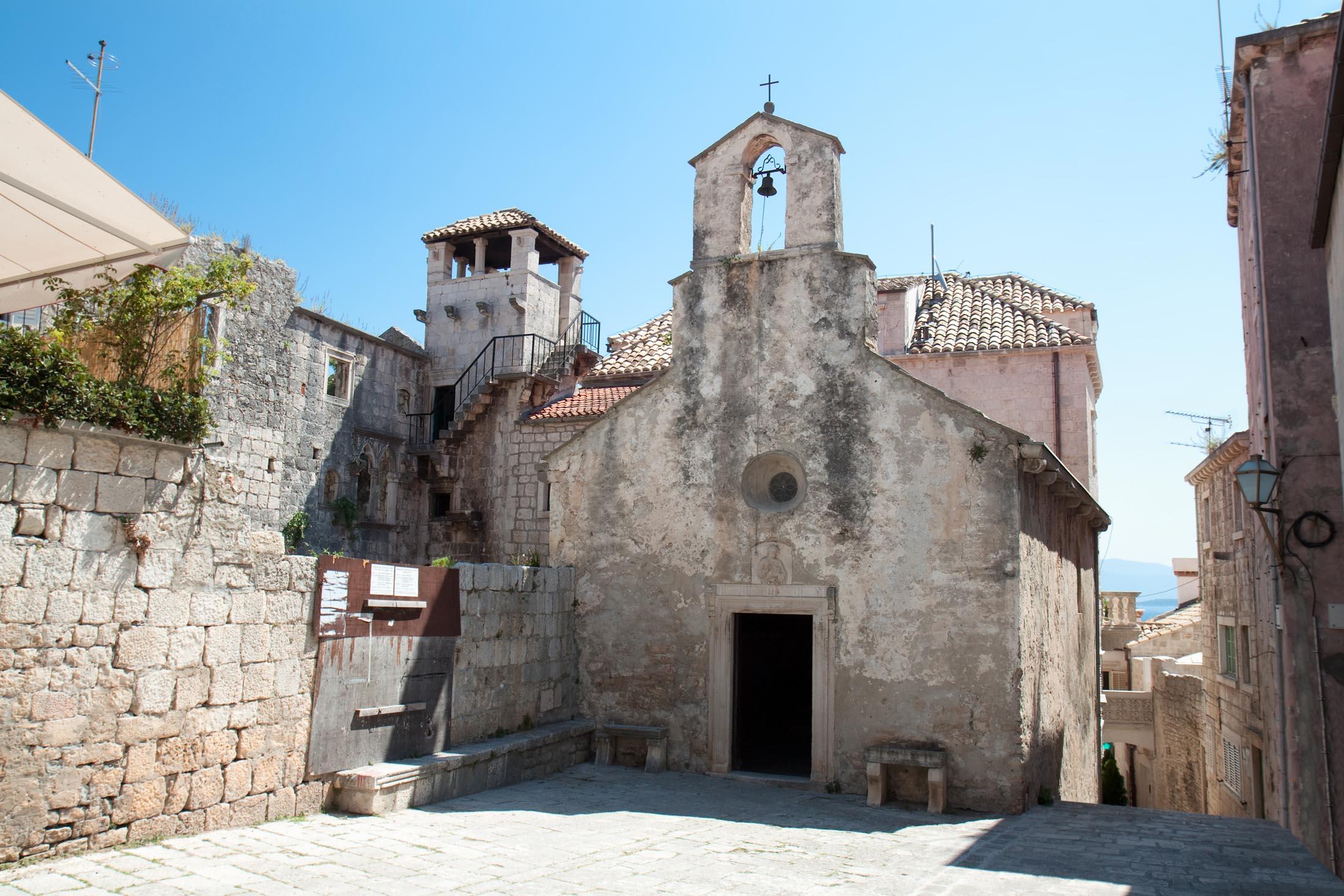 Church and Marco Polo tower in Korcula, Croatia.