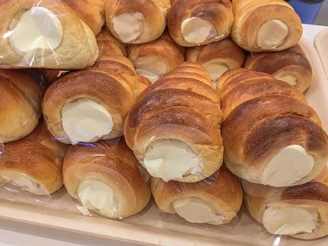 Cornet cream horns in bakery shop.