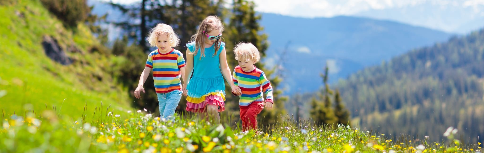 Family Vacations - Children Hiking in the Alps