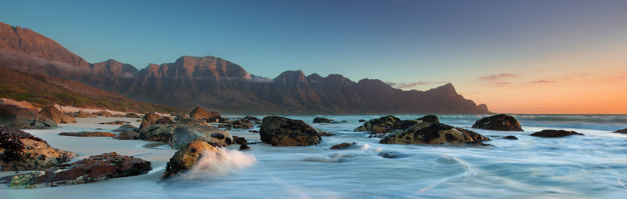 The sun sets over Kogel Bay in the Cape Province, South Africa