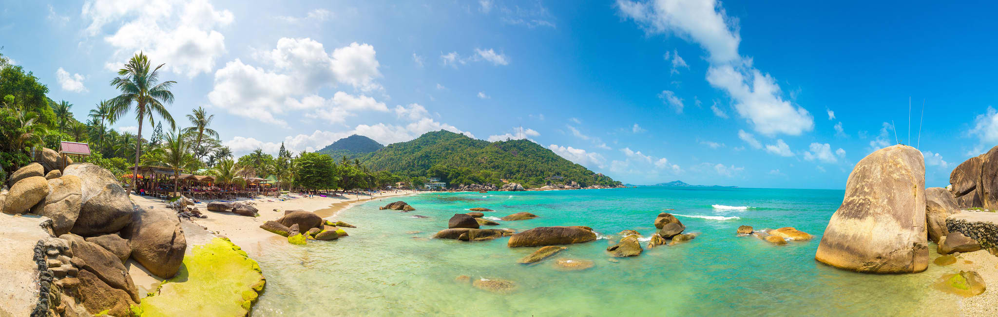 Thailand coastline with light blue waters and white sand