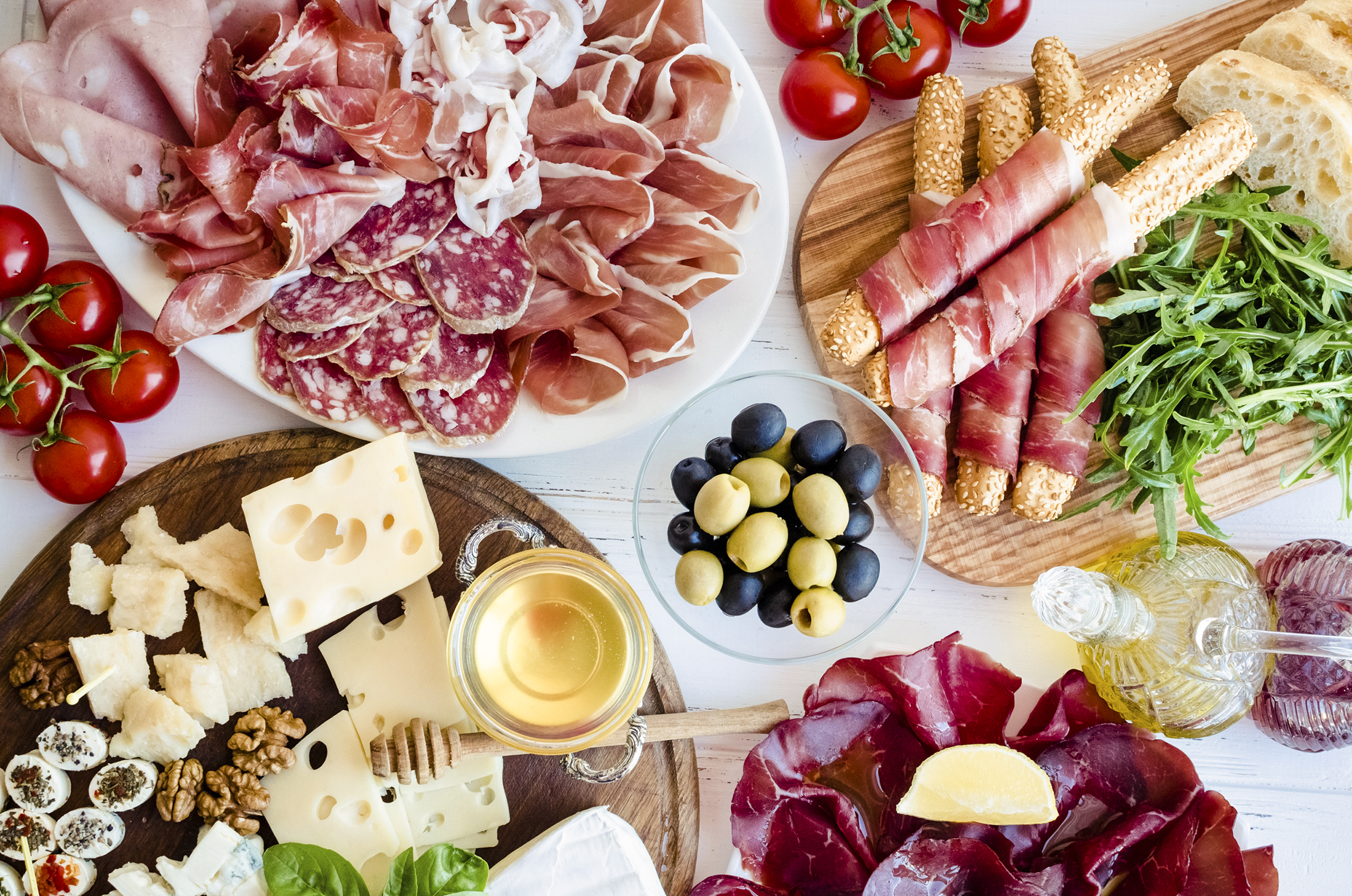 An antipasto comprised of assorted meats and cheeses.