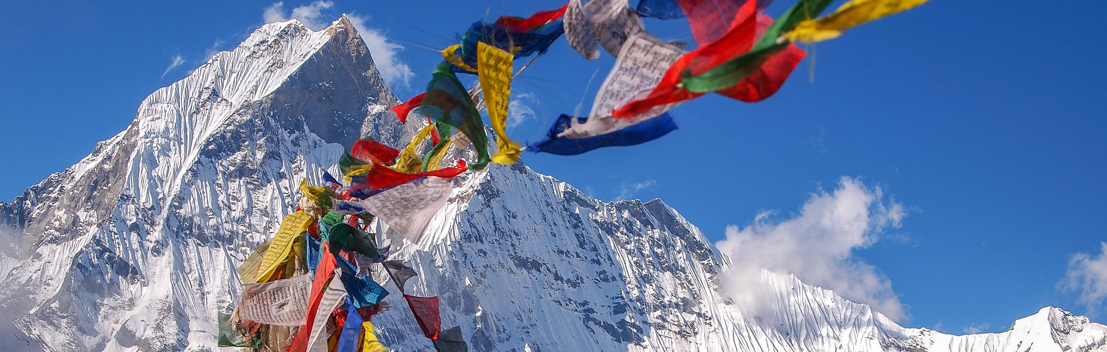 Prayer flags near the summit in the Himalayas of Nepal.