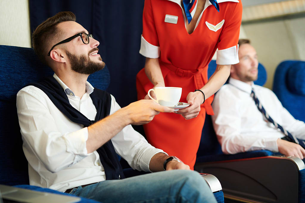 man_served_coffee_flight_attendant