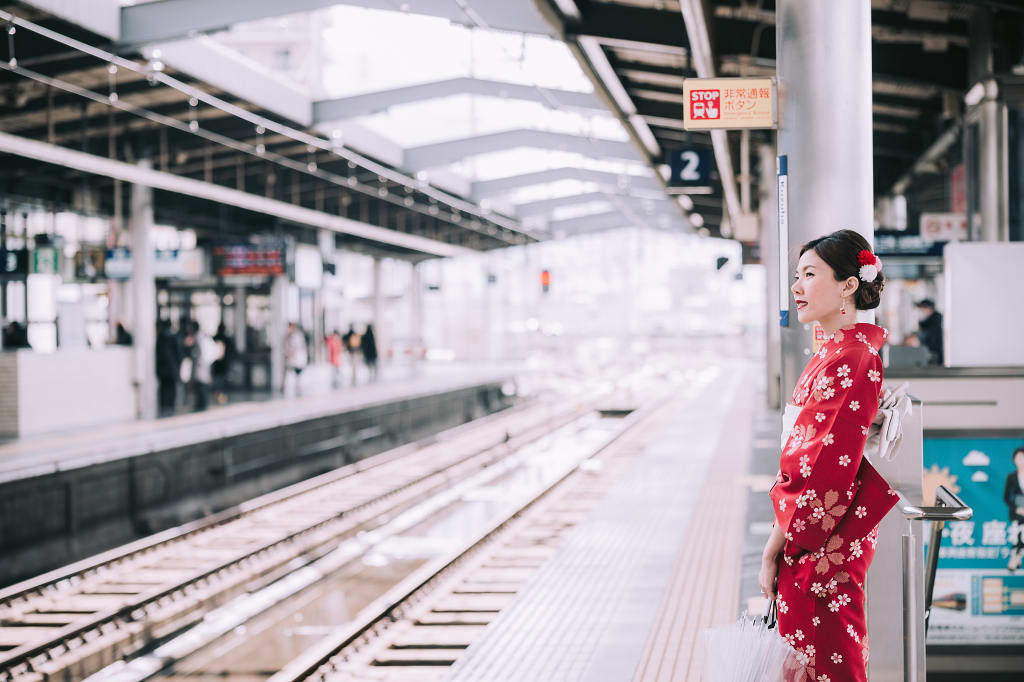 Japanese Woman standing at subway train platform