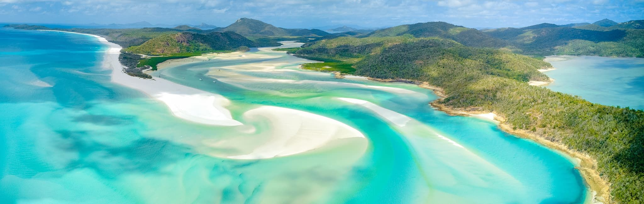 Aerial view of The Whitsunday Islands, between the coast of Queensland, Australia and the Great Barrier Reef.