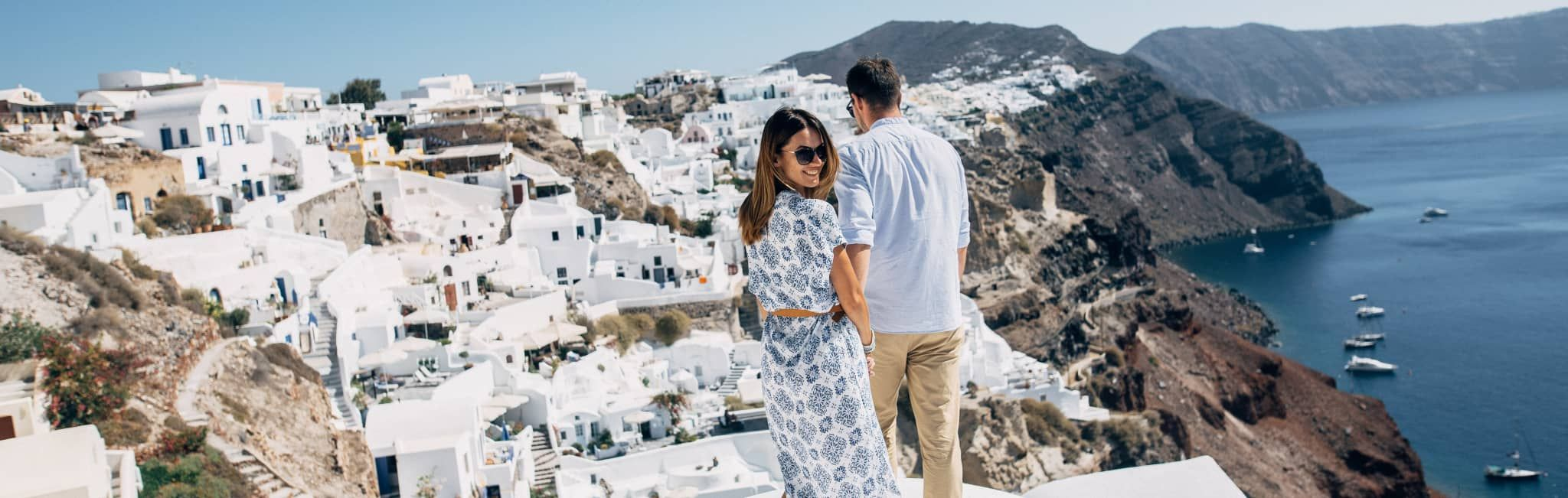 Couple admiring the view in Santorini, Greece