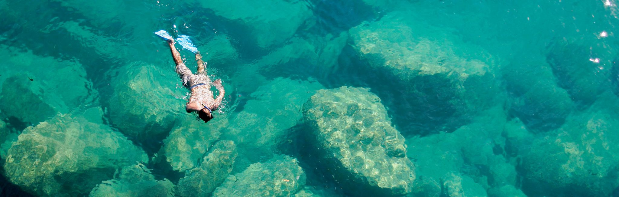 A snorkler in the clear waters of Lake Malawi.