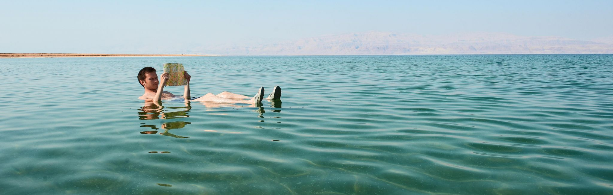 A man floats in the salty Dead Sea in Israel.