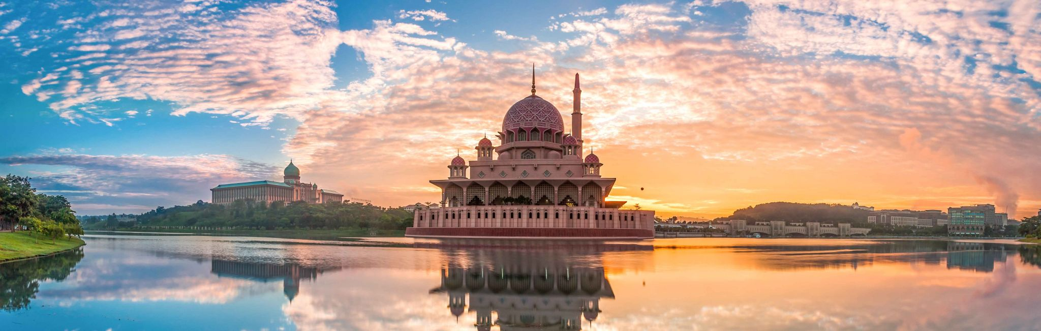 A reflection of the Putra Mosque at sunset in Malaysia.
