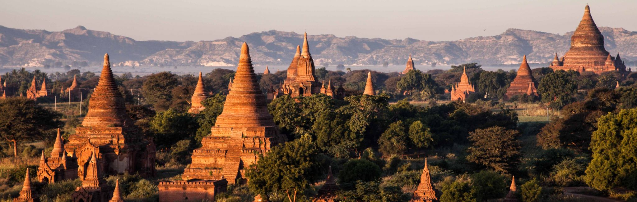 A sunrise over a temple complex in Myanmar.