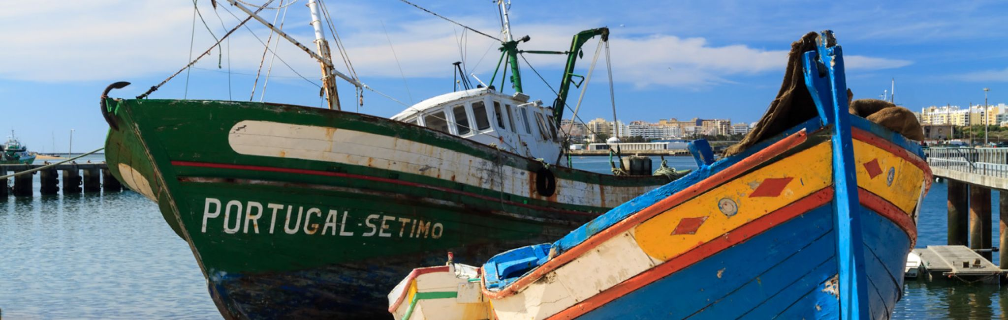 Colorful, old fishing boats in Algarve, Portugal.