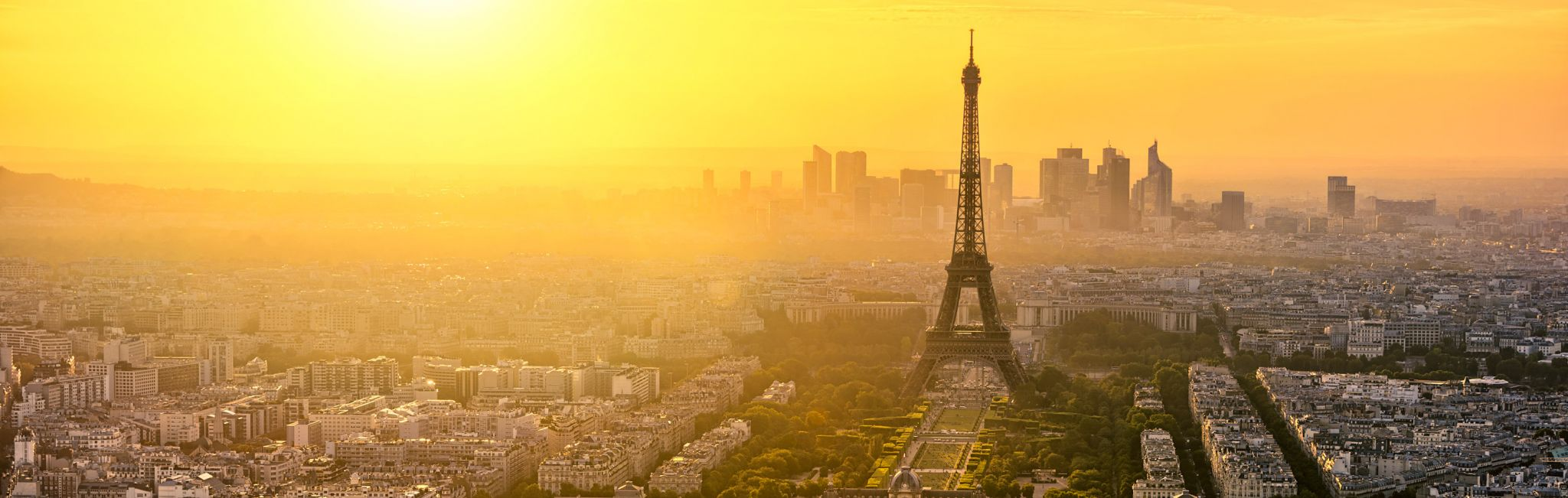 An aerial view of the Eiffel Tower at sunset.