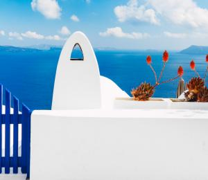 The classic white and blue architecture of Greece with an ocean view
