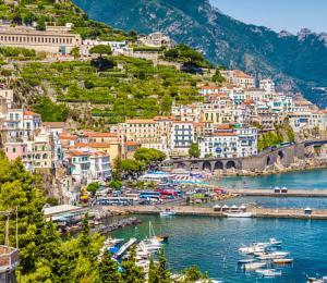 Italy Amalfi Coast port with ships and boats.