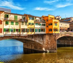 The Ponte Vecchio Bridge hanging over the Arno River in Florence, Italy