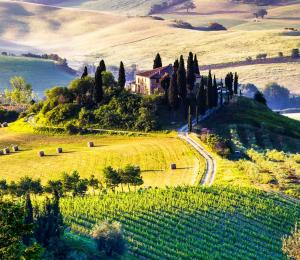 Tuscany landscape with a house on a hilltop