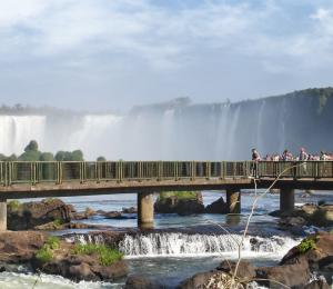 Visitors get a stunning view of Iguazu Falls from a viewing platform.