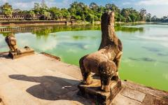 View of Angkor Wat over water.
