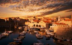 View of Dubrovnik harbor at sunset.