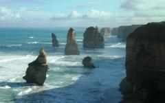 view of the rock formations known as the twelve apostles on a cloudy day