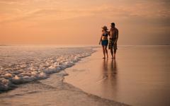 australia cabe beach broome couple walk on the beach at sunset