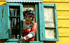A colorful figure greets visitors to La Boca, one of Buenos Aires' most popular neighborhoods.
