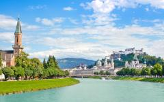 The skyline of Salzburg and the Salzrach River.