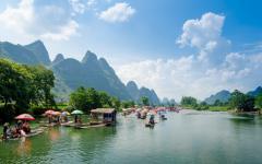 Boats float down the Yangshou through beautiful Guilin.