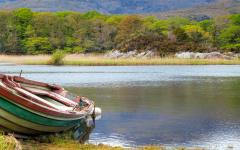 An old boat on a lake in the Ring of Kerry, Ireland.