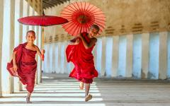 Myanmar Tour - Young monks running at temple in Bagan
