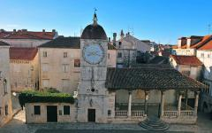 View of the clock in Trogir, Croatia.