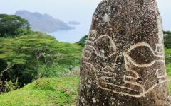 carvings on a stone in the jungle