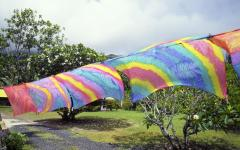 tie dye sarongs drying on a clothes line and blowing in the wind