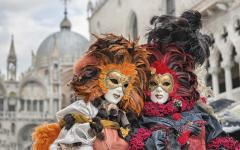 Masked and costumed couple in Venice during Carnevale