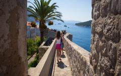 Tourists explore the old town in Dubrovnik, Croatia.