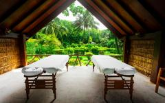 massage tables in an open bungalow with jungle view