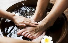 foot massage in a bowl of water