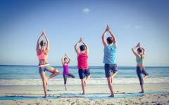 small yoga class on the beach