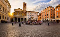 An inside courtyard view of the Basilica di Santa Maria at sunset in Roma, Italy