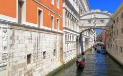 A canal with gondolas running underneath the Bridge of Sighs in Venice, Italy