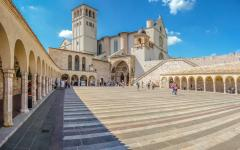 A courtyard view of the Cathedral Basilica of St. Francis of Assis in central Italy