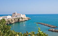 View of a beach town on a sea cliff in Vieste, Italy