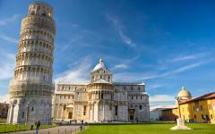 The Leaning Tower of Pisa and Piazza Dei Miracoli standing side by side in Pisa, Italy