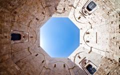 An upward view of the sky from inside the Casta Del Monte in Puglia, Italy