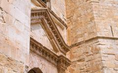 Close-up view of the intricate architecture of the Castel Del Monte in Puglia, Italy