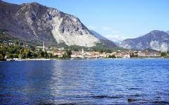 Lake Maggiore with European town and mountain range in the background