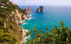 Beautiful view of a rocky cliff and coastline in Capri, Italy