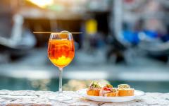 Aperol Spritz drink with appetizers.