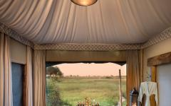 View from guest bathroom at Duba Plains. Photo courtesy of Great Plains Conservation.